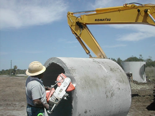 Beveling a Piece of Cut Concrete Pipe to Prepare for Installation into an A•LOK X•CEL Connector